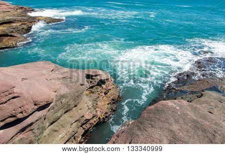 Turquoise Indian Ocean waters and natural coastal sandstone outcroppings at Pot Alley in Kalbarri, Western Australia.