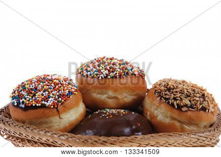 traditional jewish holiday chanuka donuts covered by dark chocolate on retro vintage basket isolated on white background