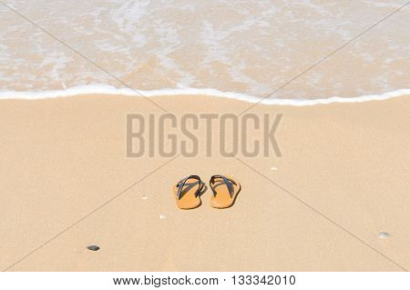 Tropical vacation concept - Flipflops on a sandy beach