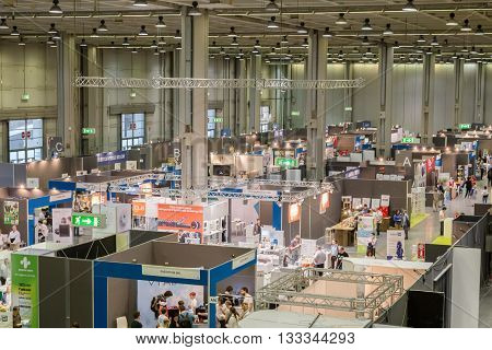 Top View Of People And Booths At Technology Hub In Milan, Italy