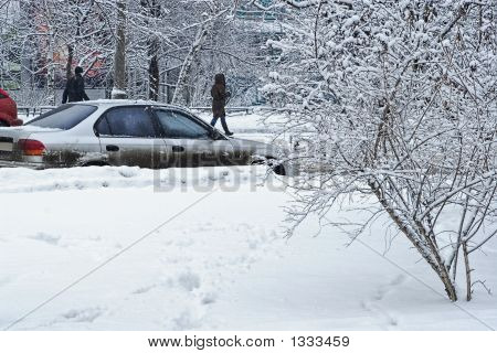 Car During A Snowfall In Town