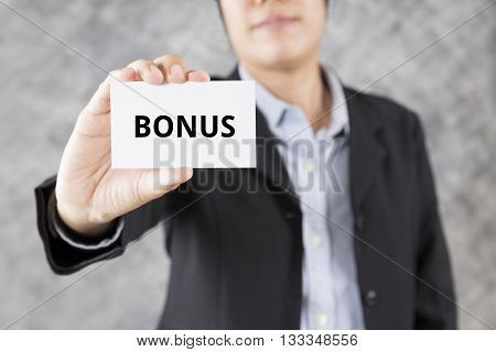 Businessman Presenting Business Card With Word Bonus