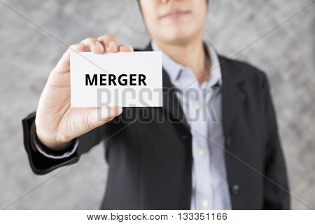 Businessman Presenting Business Card With Word Merger
