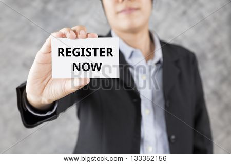 Businessman Presenting Business Card With Word Register Now