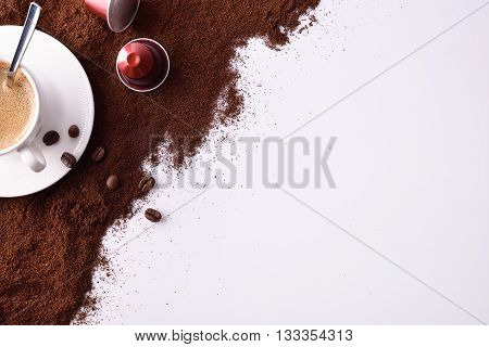 Cup Of Espresso With Ground Coffee Top View