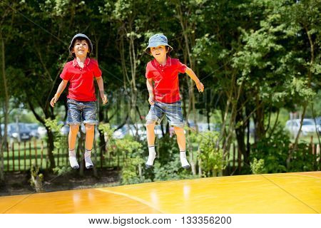 Two Sweet Children, Boy Brothers, Jumping On A Big Trampoline