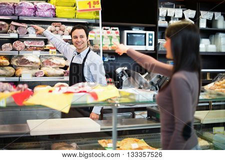 Shopkeeper serving a customer in his grocery store