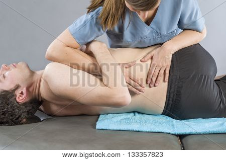Physiotherapist Doing Manipulation To Man Patient. Osteopathy.