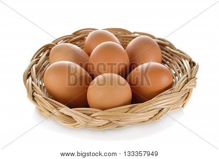 fresh eggs in the rattan basket on white background