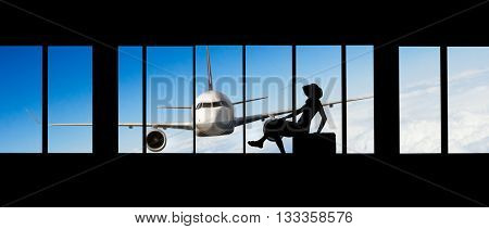 Young woman silhouette at Airport with suitcase. Big passengers plane on background. Travel concept of air transportation