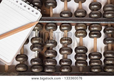 Old abacus and notebook for taking notes