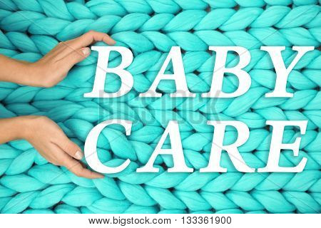 Knitted woolen background. Baby care concept