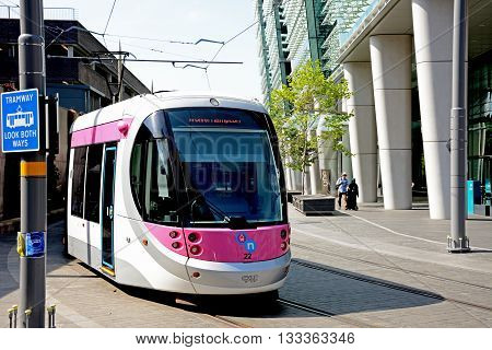 BIRMINGHAM, UK - JUNE 6, 2016 - Midland Metro city centre extension Tram along Colmore Circus Birmingham England UK Western Europe, June 6, 2016.