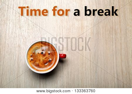 Cup of coffee on light background, top view