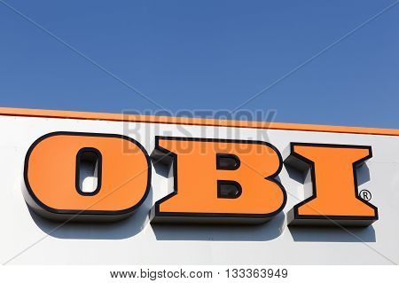 Flensburg, Germany - June 4, 2016:  Obi sign on a wall of a store. Founded in 1970, Obi is the largest do it yourself retailer in Europe and the third largest in the world.