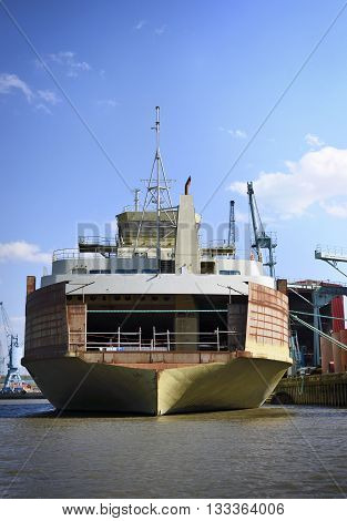 Industrial ship at a container harbor. Freight transportation or freight shipping. Hamburg harbor, Germany.