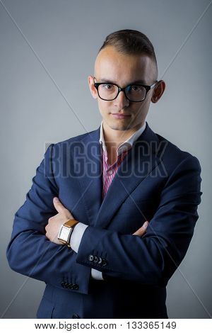 Young Stylish Man In Suit And Glasses