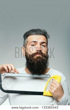 Bearded Man With Saw