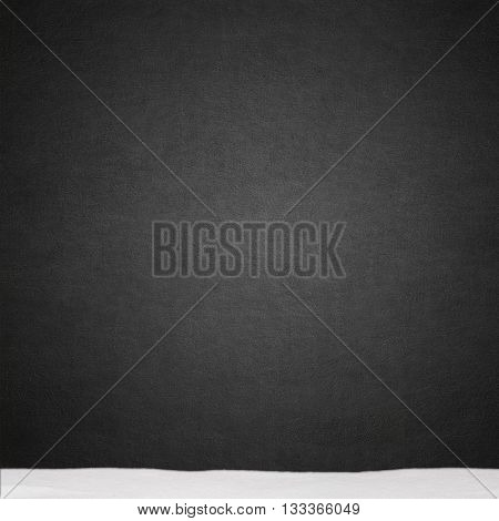 black stucco wall and snow texture background