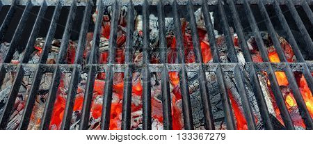 Hot Barbecue Cast Iron Grill With Glowing Charcoal Background
