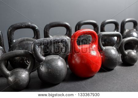 Different sizes of kettlebells lying on gym. Equipment for training at fitness club