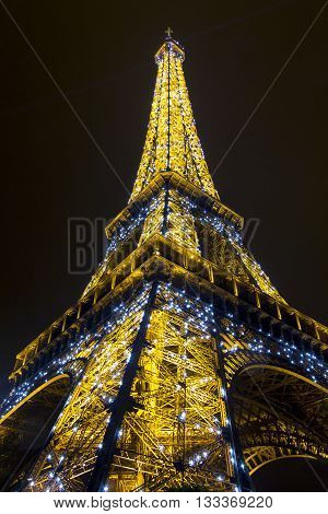 PARIS, FRANCE - MAY 14, 2013: This is view of the top of the Eiffel tower in the night illumination of its backlight.