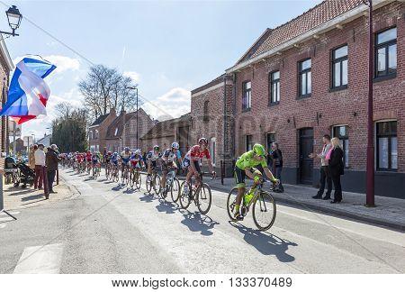 Louvil France - April 102016: The peloton riding in Louvil France during Paris Roubaix on 10 April 2016.