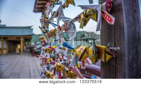 Japanese omikuji, or fortune slip, found at shrines or temples in Japan. These contain small slips of paper with prayers and wishes.