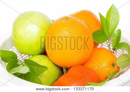 Fresh fruits in strainer drain after washing