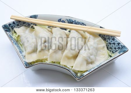 close up Japanese Gyoza dumplings with dipping sauce