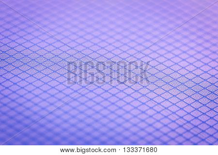 Background of narrow close focus on purple texture fabric of polyester fiber and nylon. It designed as crossing pattern of crosswise rhombus which surround by slightly vignette.