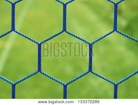 Blue Crossed Soccer Football In Goal Net, Thin Rope