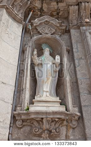 PORTO PORTUGAL - MAY 26 2016: Statue of Prophet Elias on facade of Carmo Church (18th c.) in the historical center of Porto Portugal. World Heritage Site of UNESCO
