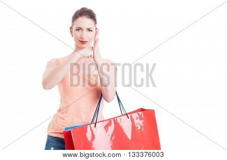 Furious Lady Holding Shopping Bags Hitting Fist In Palm Gesture