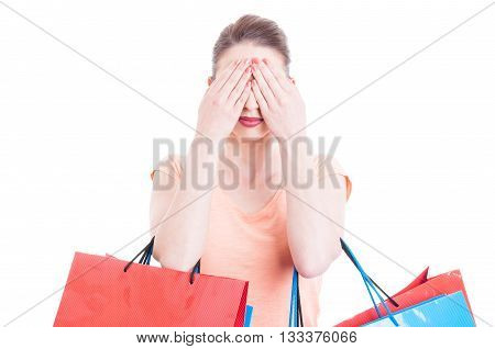Young Lady Holding Shopping Bags Making Blind Gesture