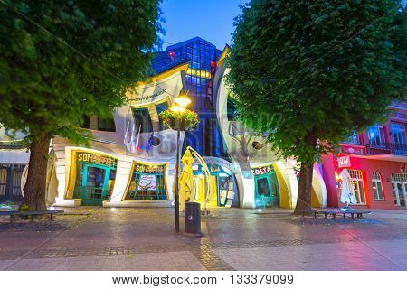 SOPOT, POLAND - JUNE 6, 2016: The Crooked house on the Heroes of Monte Cassino street in Sopot, Poland. The Crooked House is an irregularly-shaped, one of fifty strangest buildings of the world.