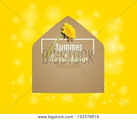 Kraft envelope. Kraft envelope with dandelion. yellow background