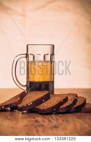 Russian Brew In Mug And Loaf Of Rye Flour On Wooden Background