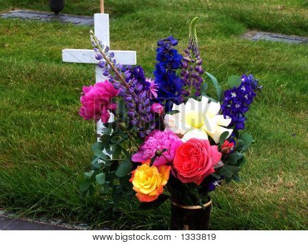 Bouquet & Cross At Grave