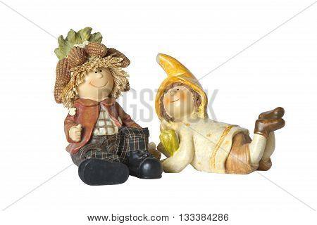 vintage German toy dwarfs with corn on white background