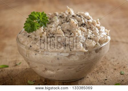Creamy fish pate in bowl made with tuna onion and butter