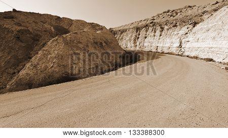 Asphalt Road in the Negev Desert in Israel Vintage Style Sepia