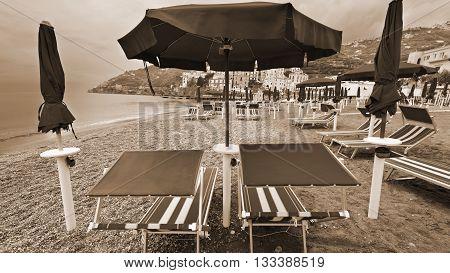 Beach Umbrellas on the Background of the Italian City of Minori Vintage Style Sepia