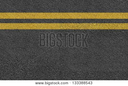 Double Yellow Line On New Asphalt Road texture background