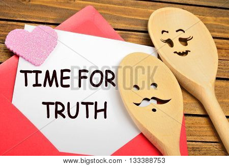 The words Time for truth on white paper