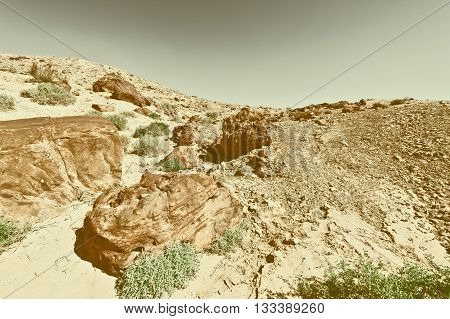 Big Stones of Grand Crater in Negev Desert Israel Retro Image Filtered Style