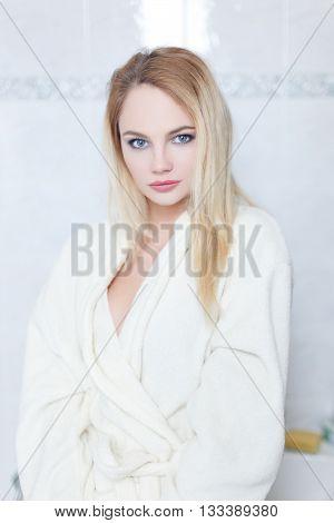 Fresh blonde woman at morning in bathroom portrait