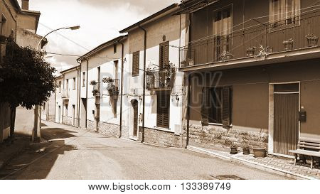 Italian Balconies Decorated with Fresh Flowers Vintage Style Sepia