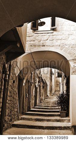 Street as Stairway in Italian Medieval City Vintage Style Sepia