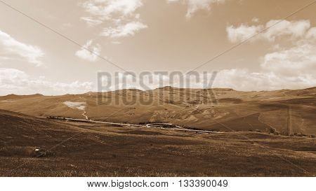 Landscape of Sicily with Asphalt Road Vintage Style Sepia